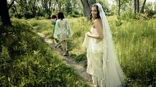 Sarah Selecky follows her bridesmaids along a path on Toronto's Algonquin Island last August. Prior to the big day, the bride-to-be invited friends over for a spring crafting session that included making paper cones and silk-screening cards.