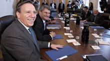 Francois Legault, left, leader of the Coalition Avenir Quebec and legislature party leader Gerard Deltell smile at their first party caucus Wednesday, January 25, 2012 at the legislature in Quebec City. (Jacques Boissinot/THE CANADIAN PRESS/Jacques Boissinot/THE CANADIAN PRESS)