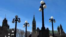 Cellphone tracking devices known as IMSI catchers were deployed near Parliament Hill is framed by lights on Major's Hill Park in Ottawa on Monday, April 3, 2017. (Sean Kilpatrick/THE CANADIAN PRESS)