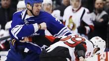Toronto Maple Leafs Frazer McLaren clobbers the Ottawa Senators' David Dziurzynski during this week in Toronto. (MARK BLINCH/REUTERS)