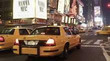 Taxis driving through times square in New York. (Stockbyte/Thinkstock)