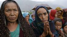 A female villager named Ramaya clasps her hands as she pleads for food after an aid relief helicopter lands at the remote mountain village of Gumda, near the epicenter of Saturday's massive earthquake in the Gorkha District of Nepal, Wednesday, April 29, 2015. (Wally Santana/ASSOCIATED PRESS)