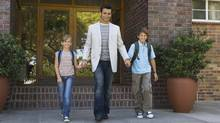 For some people, success is determined by how much time they spend with their children, including taking them to and from school. (PHOTOS.COM)