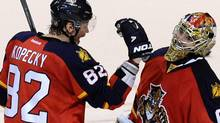 Florida Panthers' Tomas Kopecky (L) congratulates goalie Jose Theodore (R) on his shutout against the New Jersey Devils following their NHL Eastern conference quarterfinal playoff hockey Game 5 in Sunrise, Florida April 21, 2012. REUTERS/Rhona Wise (RHONA WISE)