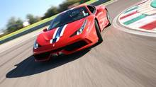 Our test driver finds the new 458 Speciale, above in Ferrari red, naturally, is perhaps the best handling car in the world, with a flat nose that inhales corners. (Michael Bettencourt for The Globe and Mail)