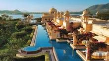 The run rises over the luxurious Udaivilas Oberoi Hotel in Udaipur, India. (Martin Harvey)