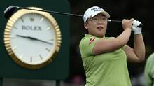 Jiyai Shin of South Korea watches her tee shot on the first hole during the first round of the LPGA Golf Championship in Pittsford, New York, June 24, 2010. (ADAM FENSTER/REUTERS)