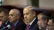 Israel's Prime Minister Benjamin Netanyahu, at the weekly cabinet meeting in Jerusalem, Sunday, July 28, 2013. (AP Photo/Ronen Zvulun, Pool) (Ronen Zvulun/AP)