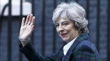 Theresa May surprised many by linking trade with security in her letter. (NEIL HALL/REUTERS)
