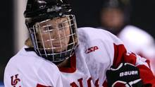The University of Calgary Dinos and Hayley Wickenheiser won the 2012 CIS women's hockey championship on Sunday, defeating the Montreal Carabins 5-1. THE CANADIAN PRESS/Darryl Dyck (Darryl Dyck/CP)
