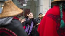 Ayla Brown, a member of the Heiltsuk First Nation in Bella Bella, protests outside the Vancouver offices of the DFO on Monday. (John Lehmann/The Globe and Mail)