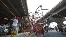 Summer Campers with the Wellesley Community Centre climb a play structure at the newly opened Underpass park in Toronto, August 02, 2012. (Deborah Baic/The Globe and Mail)