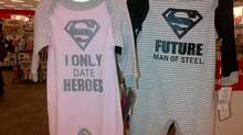 Pajamas for three-month-old girls and boys are seen at a Target store in Waterloo, Ont., on Sunday Sept. 28, 2014. The photograph has sparked a social media debate about gender stereotyping of babies. (Christine Logel/THE CANADIAN PRESS)