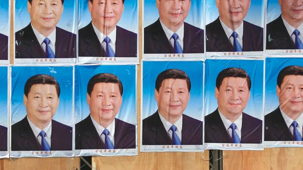 Some of the hundreds of posters depicting Chinese President Xi Jinping that recently coated a building in Shanghai: An imperial personality in the making?