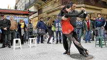 The tango is everywhere in Buenos Aires, from street corners to cemeteries to the city's many milongas. (DANIEL GARCIA/AFP/Getty Images/DANIEL GARCIA/AFP/Getty Images)