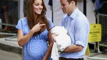 Britain's Prince William and his wife Catherine, Duchess of Cambridge appear with their baby son outside the Lindo Wing of St Mary's Hospital, in central London July 23, 2013. Kate gave birth to the couple's first child, who is third in line to the British throne, on Monday afternoon, ending weeks of feverish anticipation about the arrival of the royal baby. (CATHAL MCNAUGHTON/REUTERS)