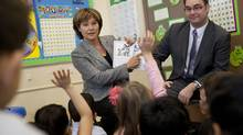 B.C. Premier Christy Clark and Education Minister Don McRae read a book to a Grade Two class at K.B. Woodward Elementary School in Surrey, B.C., on Jan. 24, 2013. (Deborah Baic/The Globe and Mail)