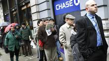 People wait in line to enter the NYCHires Job Fair in New York, Feb. 24, 2010. (© Shannon Stapleton / Reuters/Shannon Stapleton / Reuters)