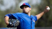 Toronto Blue Jays starting pitcher Ricky Romero pitches against the Minnesota Twins during first inning Grapefruit League action Dunedin, Fla., on Tuesday, Feb. 26, 2013. (Nathan Denette/THE CANADIAN PRESS)