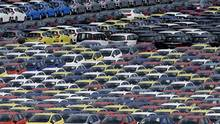 Newly manufactured Honda cars await export at port in Yokohama, Japan. Under the TPP pact, the elimination of a 6.1 per cent tariff on passenger vehicles could reduce prices for Japanese cars by $1,000 or more. (Toru Hanai/REUTERS)