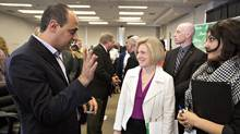 Alberta Premier Rachel Notley, centre, speaks with small business owners and non-profit businesses during a prebudget meeting attends a prebudget meeting at the Alberta School of Business in Edmonton on Wednesday. (JASON FRANSON/THE CANADIAN PRESS)