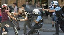 Police use pepper spray to disperse protesters during an arrest near the Montreal Grand Prix auto race on June 10, 2012. (Peter Mccabe/The Canadian Press)
