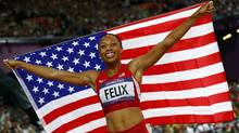 Allyson Felix of the U.S. celebrates after she won gold in the women's 200m final during the London 2012 Olympic Games at the Olympic Stadium August 8, 2012. (KAI PFAFFENBACH/REUTERS)