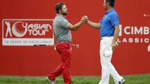 Ryan Moore beats Gary Woodland in a playoff in Malaysia