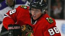Patrick Kane #88 of the Chicago Blackhawks brings the puck up the ice past Wayne Simmonds #17 of the Los Angeles Kings at the United Center on November 9, 2009 in Chicago, Illinois. The Blackhawks defeated the Kings 4-1. (Jonathan Daniel/Getty Images)