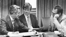 Liberal MPs Jean-Luc Pepin, left to right, Art Phillips and Herb Gray discuss strategy in preparation for the opening of Parliament in Ottawa in this 1979 file photo. Former Vancouver mayor Art Phillips passed away on Friday at the age of 82. Phillips served as the city's mayor in the 1970s and was responsible for municipal decisions that paved the way for downtown densification, including the fight against a waterfront freeway. (Peter Bregg/THE CANADIAN PRESS)
