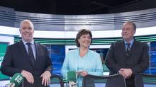B.C. NDP leader John Horgan, left to right, Liberal Leader Christy Clark and B.C. Green Party leader Andrew Weaver pose for a photo following the leaders debate in Vancouver, B.C., Thursday, April 20, 2017. (JONATHAN HAYWARD/THE CANADIAN PRESS)