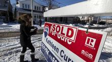 Real estate 'Sold' and 'For Sale' signs in Toronto's East end on Dec. 16, 2013. (Deborah Baic/The Globe and Mail)