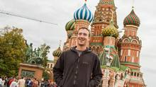 Facebook Chief Executive Mark Zuckerberg poses for a picture in front of the St. Basil's Cathedral in Red Square in Moscow, September 30, 2012. Picture taken September 30, 2012. REUTERS/Facebook Press Service/Handout (RUSSIA - Tags: BUSINESS SCIENCE TECHNOLOGY CITYSPACE TRAVEL) NO SALES. NO ARCHIVES. FOR EDITORIAL USE ONLY. NOT FOR SALE FOR MARKETING OR ADVERTISING CAMPAIGNS. THIS IMAGE HAS BEEN SUPPLIED BY A THIRD PARTY. IT IS DISTRIBUTED, EXACTLY AS RECEIVED BY REUTERS, AS A SERVICE TO CLIENTS (HANDOUT/REUTERS)