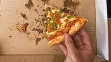 Extras like eating pizza can break the piggy bank. (Photos.com)