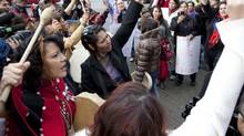 Women sing and chant outside of the missing women inquiry in downtown Vancouver, Tuesday, Oct. 11, 2011. (Jonathan Hayward/The Globe and Mail/Jonathan Hayward/The Globe and Mail)