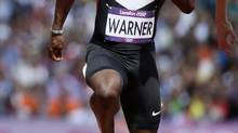 Canada's Justyn Warner runs during the men's 100m round 1 heats at the London 2012 Olympic Games at the Olympic Stadium August 4, 2012. (LUCY NICHOLSON/REUTERS)