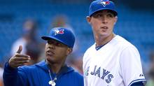 Toronto Blue Jays pitchers Marcus Stroman, left, and Aaron Sanchez talk before the Blue Jays take on the Boston Red Sox during first inning AL baseball action in Toronto on Tuesday, July 22, 2014. (The Canadian Press)