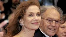 Cast members Isabelle Huppert and Jean-Louis Trintignant arrive on the red carpet for the screening of the film Amour at the 65th Cannes Film Festival, May 20, 2012. (ERIC GAILLARD/ERIC GAILLARD/REUTERS)
