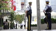 RCMP officers in Toronto. (Roger Hallett/Roger Hallett for The Globe and Mail)