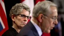Kathleen Wynne, left, and Energy Minister Bob Chiarelli are holding a $6,000-a-person cocktail-and-dinner event for fewer than 30 donors at 6 p.m. on Thursday at the tony Four Seasons hotel in Toronto's Yorkville neighbourhood. (Moe Doiron/The Globe and Mail)