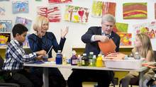 Prime Minister Stephen Harper and his wife Laureen do arts and crafts with students at the Joseph and Wolf Lebovic Jewish Community Campus in Vaughan, Ont., on Wednesday, October 30, 2014. (Nathan Denette/THE CANADIAN PRESS)