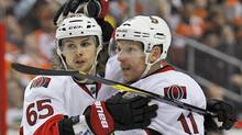 Ottawa Senators defenseman Erik Karlsson, left, celebrates with right wing Daniel Alfredsson after Alfredsson's goal in the first period of an NHL hockey game against the Philadelphia Flyers, Saturday, March 31, 2012 in Philadelphia. (Associated Press)