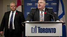 Toronto Mayor Rob Ford makes a statement to the media at City Hall on Nov. 5, 2013, while his brother, Doug Ford, looks on. (DEBORAH BAIC/THE GLOBE AND MAIL)