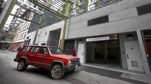 A truck enters a parking garage in the rear of a Gastown condominium at 60 West Cordova in Vancouver June 4, 2012. (Jeff Vinnick/The Globe and Mail)