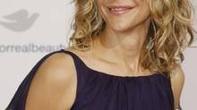 "Actress Meg Ryan, star of the film ""The Women"", poses at the film's premiere in Los Angeles September 4, 2008 (FRED PROUSER/REUTERS)"