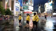 (LtoR) Toronto Police Constables Melissa Huntley, Marty McLaughlin and Sergeant Mike Hayles of 51 Division on patrol at Yonge-Dundas Square (Deborah Baic/The Globe and Mail)