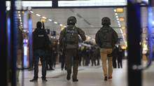 Special police forces walk in the main train station in Duesseldorf, western Germany, on March 9, 2017 after several people have been injured in an attack with an axe. (David Young/AP)