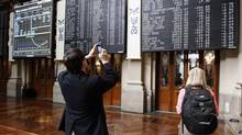 Visitors take pictures at the Madrid stock exchange June 22, 2012. (ANDREA COMAS/REUTERS)