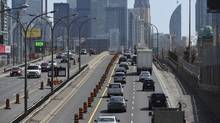 As seen from the Dufferin St bridge, traffic on the eastbound Gardiner Expressway slowly heads into the city after one lane in each direction was closed off for long term construction. (Fred Lum/The Globe and Mail)