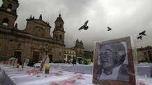 A photograph of victim missing or killed in armed conflict in Colombia is displayed during a tribute at Bolivar Square in Bogota. Colombia's government and Marxist rebels promised on Thursday to seek a comprehensive peace agreement at their talks in Norway, aimed at ending nearly half a century of conflict. (JOHN VIZCAINO/REUTERS)